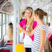 Stock Photo of Pretty, young woman on a streetcar/tramway, during her commute t