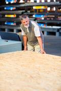 Man buying construction wood in a  DIY store Stock Photos