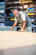 Man buying construction wood in a  DIY store - stock photo