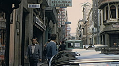 Majorca 1968: people walking in the street of the city Stock Footage