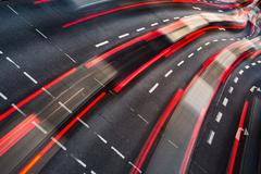 Stock Photo of Motion blurred city road traffic (color toned  image)