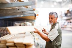 Senior man buying construction wood in a  DIY store Stock Photos
