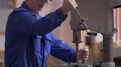 Drilling machine making a hole in a steel bar Stock Footage