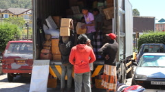 Manual Workers Unloading Truck in Sri Lanka Stock Footage