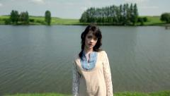 Girl by the river Stock Footage