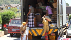 Manual Workers II Unloading Truck in Sri Lanka - stock footage