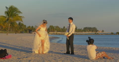 Bride and groom taking pictures on Miami Beach seaside, Florida - stock footage