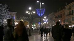 4K FHD Verona Christmas Fair Piazza Bra crowds lights street decoration Italy - stock footage