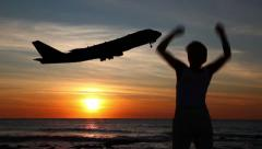Young woman waving her hands aircraft. Stock Footage