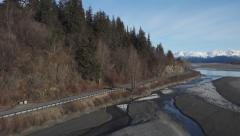 SUV Traveling South on Haines Highway Early Spring Aerial Pan Stock Footage