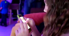 Girl sliding her smartphone touch screen Stock Footage