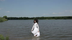 Stock Video Footage of Girl posing in lake(FLAT COLOR)
