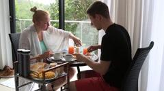 Couple enjoys breakfast on holiday Stock Footage
