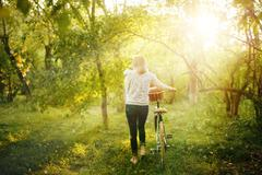 Blurred image of female with bicycle Stock Photos