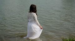 Girl posing in lake Stock Footage