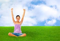 Sitting teenage girl on grass while rejoices with arms up. - stock illustration