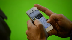 People writing a message in mobile telephone with green or chroma background Stock Footage