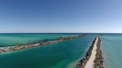 Aerials of Jetty into the ocean in the Bahamas Stock Footage