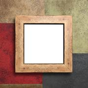 Empty wooden frame on the wall Stock Photos