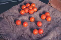 scattered cherry tomatoes - stock photo