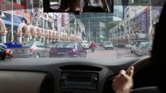 Driving through Little India in Kuala Lumpur Stock Footage