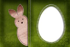 Easter bunny on textile background with space for your text Stock Photos