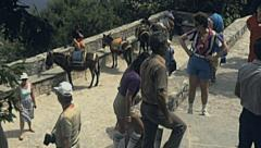Rhodes 1983: tourist watching the panorama from the top of a hill Stock Footage