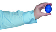 Stock Photo of Female arm holding a blue egg in the hand