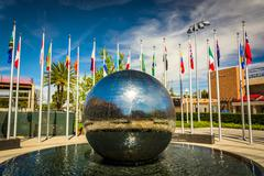 Reflecting sphere and flags at Chapman University, in Orange, California. Stock Photos