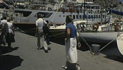 Rhodes 1983: tourist walking near the port Stock Footage