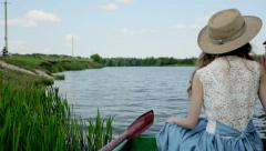 Girl resting in a boat Stock Footage
