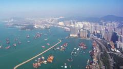 Hong Kong bird's eye view toward commercial harbor and highway road. Timelapse Stock Footage