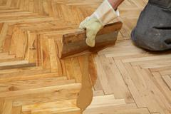 Home renovation, parquet finishing - stock photo