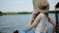 A girl sits in a boat Stock Footage