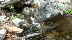 Placerita waterfalls slow zoom in colorful rocks Stock Footage