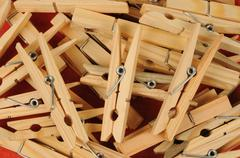 close up of a pile of clothes peg - stock photo