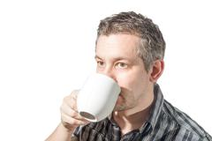 a man Drinking coffee - stock photo