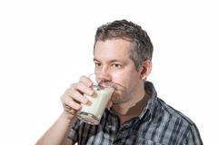 a man Drinking milk - stock photo