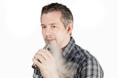 Man smoking ecigarette - stock photo