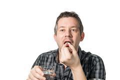 A man Taking painkiller Stock Photos