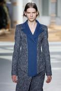 NEW YORK, NY - FEBRUARY 18: A model walks the runway at the Boss Womens fashi Stock Photos