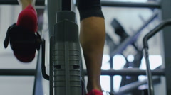 Close up of feet on an exercise bike in slow motion Stock Footage