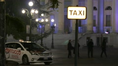 Stock Video Footage of 4K FHD Taxi sign Verona Piazza Bra at night Italy Veneto