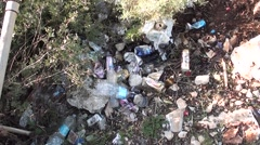 Heap of litter then nature view Stock Footage