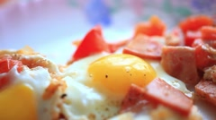 Cook puts fried eggs with vegetables in plate. Close up. HD. 1920x1080 Stock Footage