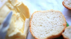 Butter smears  on Slices of Wheat Bread , closeup. HD. 1920x1080 Stock Footage