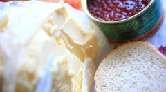Jars with red caviar, butter and bread. Making a sandwich With Butter And Red Stock Footage