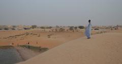 Man standing over Lake in the Desert near Nouakchott, Mauritania (4K) Stock Footage