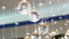 Crystal balls in the interior of the white hall. Faceted glass Stock Footage