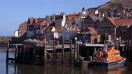 Stock Video Footage of Lifeboat and houses Whitby harbour North Yorkshire